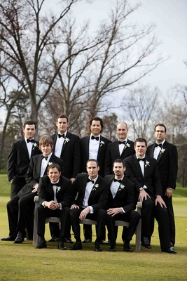 Men in tuxedos and bow ties on golf course