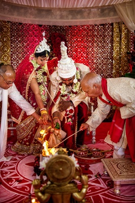 Bride and groom participate in Agni puja Indian tradition