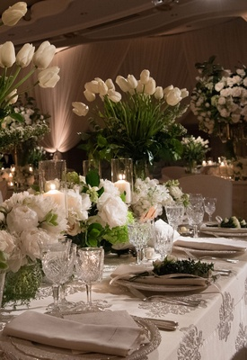 Wedding reception printed table linen crystal glassware white flowers candles tulip peony rose