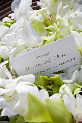 White wedding stationery card with brown hand lettering