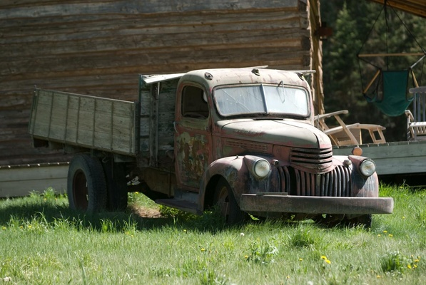 Old run down truck on grass at rustic wedding