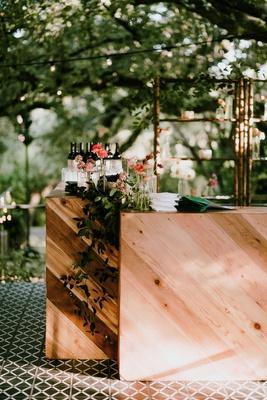 outdoor wedding pattern floor tile wood bar greenery custom napkin pink ranunculus flowers