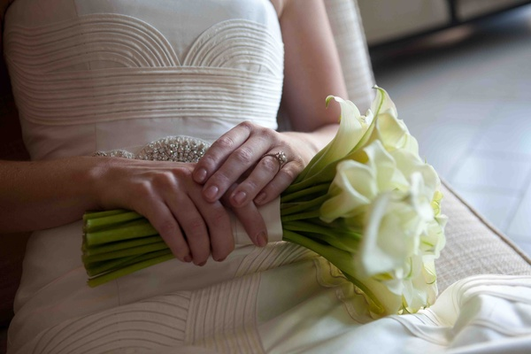 Bride holding white calla lily wedding bouquet