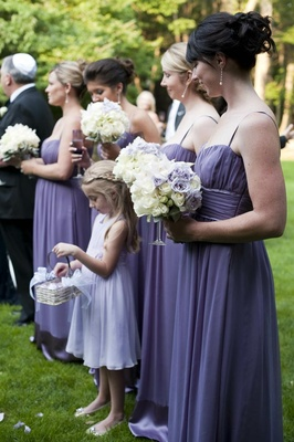 Bridesmaids with flower girl in purple dresses