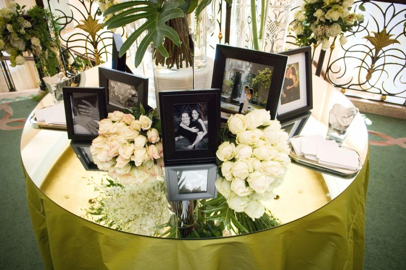 Framed Photos Of Bride And Groom On Mirror Table