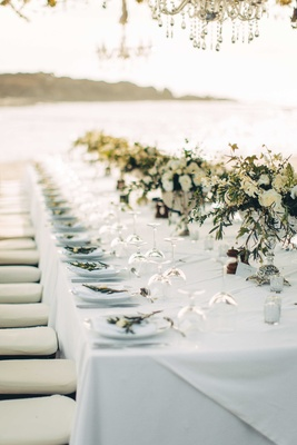 white tablescape greenery centerpieces white flowers beach destination wedding reception punta mita