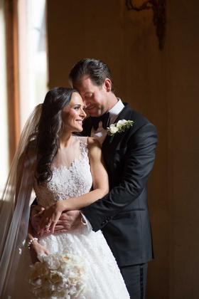 bride in ines di santo illusion wedding dress ball gown groom tuxedo bow tie new york city wedding