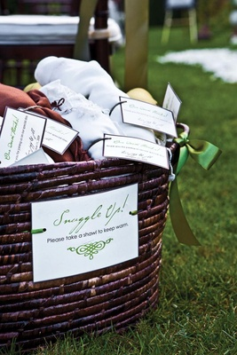 Brown wicker basket filled with ceremony wedding favors