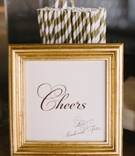 Paper straw with gilt stripes and Cheers sign