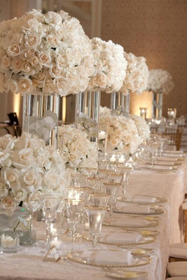 Rose floral arrangements and gold-rimmed glassware