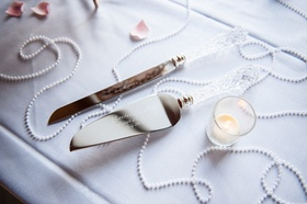 Engraved cake server and knife with crystal handles at wedding