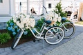 two beach cruiser bikes adorned with flowers for at-home wedding decor