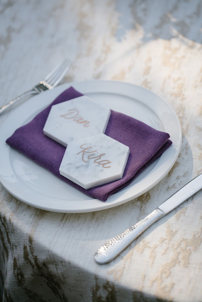 marble hexagons as place cards with calligraphy on plum napkin