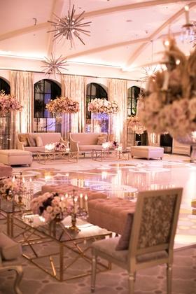 Wedding after party seating areas around dance floor starburst chandelier high centerpiece gold
