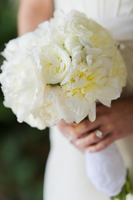 Bride carrying white peonies and roses