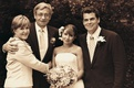Sepia tone image of bride and groom with parents