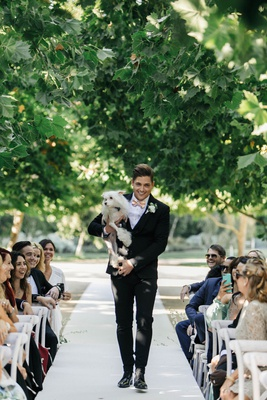 Jillian Murray and Dean Geyer wedding ceremony groomsman carrying chinese crested dog
