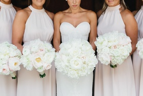 Bride with white bridal bouquet and bridesmaids with bouquets white and pink flowers