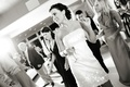 Black and white photo of bride dancing with champagne