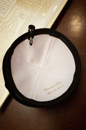 Black yarmulke with white interior and name of bride and groom, wedding date, for Jewish wedding