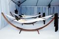 Contemporary hammocks in white reception tent