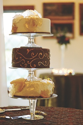 Different cakes served on clear cake stand