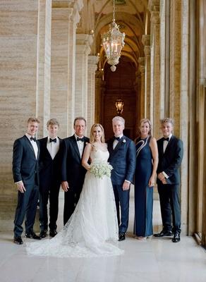 bride in romona keveza wedding dress groom in navy tuxedo custom family in navy and black