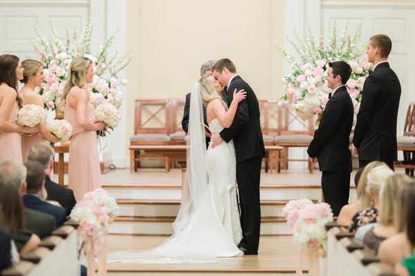 church ceremony, bride and groom's first kiss as husband and wife