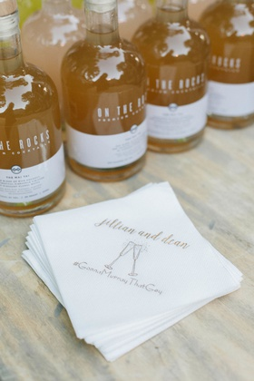 Jillian Murray and Dean Geyer wedding bar with custom napkins champagne icon and hashtag