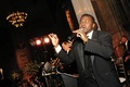 African American singer in tuxedo at reception