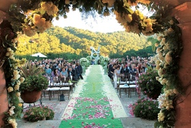 Bride and groom's view of ceremony guests from under chuppah