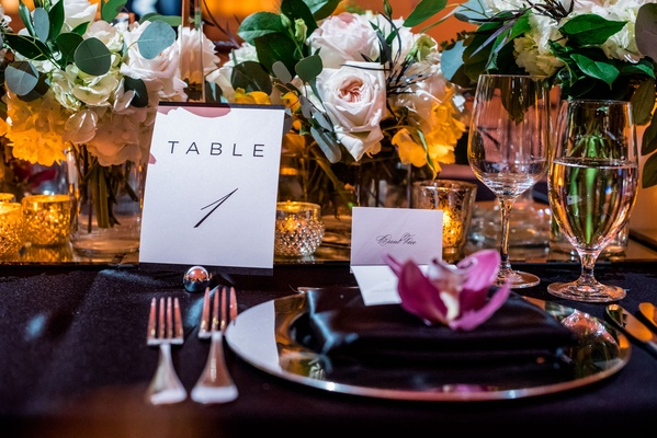 Wedding reception black linens with pink and white flowers greenery burgundy flower minimalist