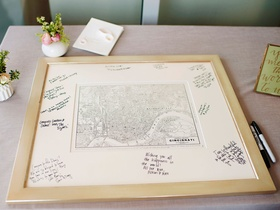 Wedding in Cincinnati with black white map and mat with signatures and well wishes from guests