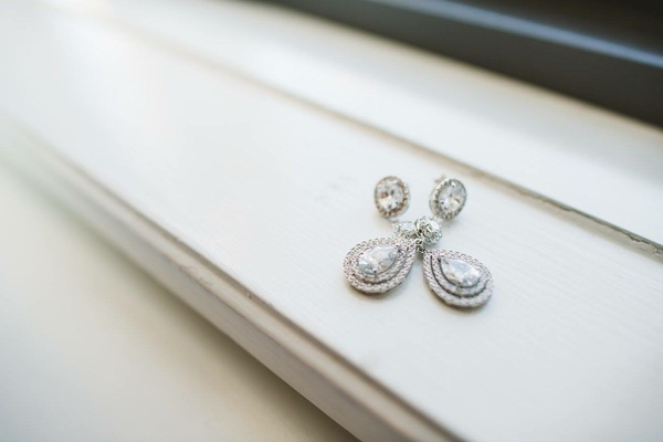 double halo teardrop earrings with diamond on ear halo design