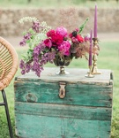 vintage teal trunk purple floral arrangement california boho chic wedding styled shoot lounge candle