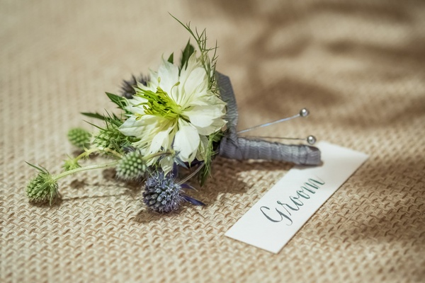 rustic wedding boutonniere with thistles and grey ribbon