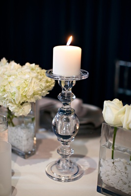 White candle on clear candlestick