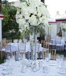 wedding reception tall centerpiece crystals greenery white hydrangea rose flowers classic