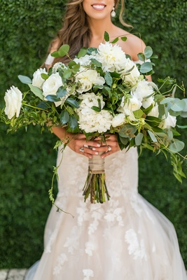 large bridal bouquet with white flowers and lots of greenery
