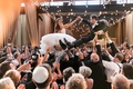 jewish hora chair dance with strings of bistro lights overhead
