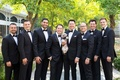 groom groomsmen smiling black bow ties dog little tuxedo outfit