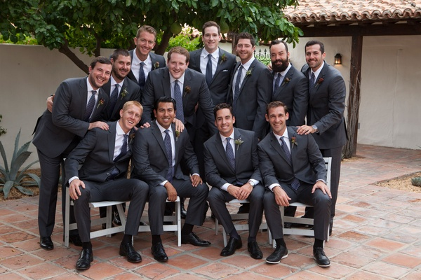 Wedding party groomsmen at la quinta resort and club in grey suits and blue ties for outdoor wedding