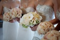 Bride and bridesmaids' bouquets in light colors