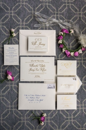 Ivory wedding invite with cobalt blue and gold calligraphy on invitation and envelope