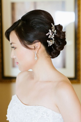 updo with flower pins around braided bun
