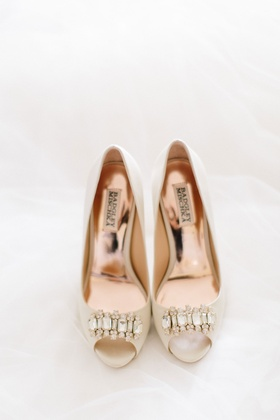 Bridal heel nude ivory shoes with crystals gold hardware details badgley mischka on white background