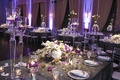 Grey crinkle linen reception table with purple lighting