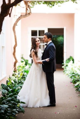 Skirball Cultural Center wedding bride in Sabrina Dahan wedding dress groom in tuxedo smiling
