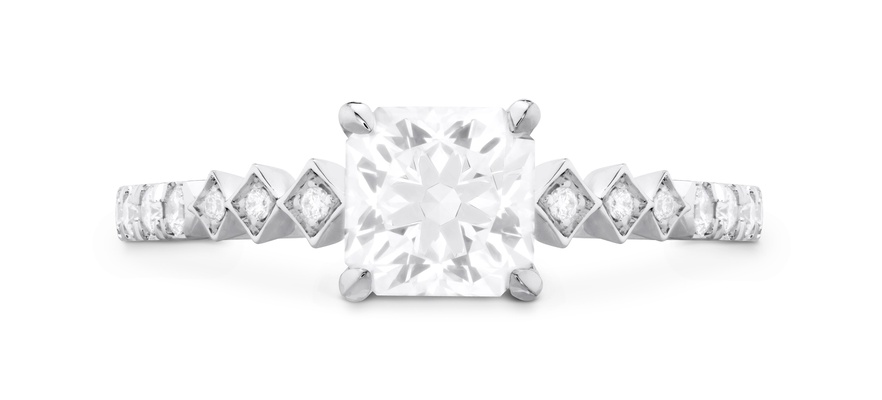 Hearts On Fire Diamond accent stone princess cut center stone four prongs engagement ring
