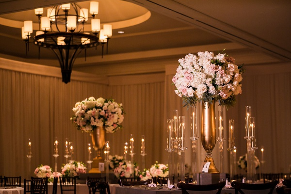 indian wedding reception ballroom chandelier gold vase tall candelabra pink white flowers rose